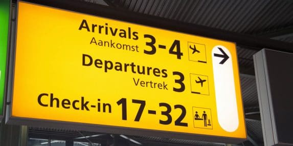 Airport sign: Arrivals, Departures, Check-in
